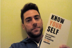 "Stefano Pecci with his book ""Know yourself"""