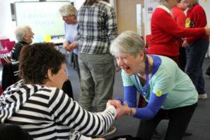 Caroline Carr giving a laughter yoga workshop