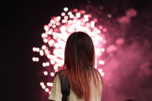 Young woman with fireworks